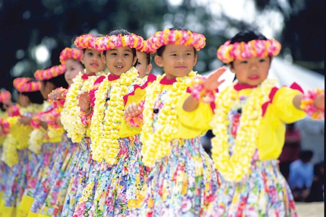Keiki perpetuate the traditional Hawaiian dance form hula.