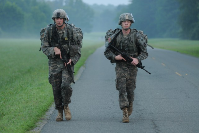 Sgt. Robert Keifer (left), infantryman, Honor Guard Company, 3d U.S. Infantry Regiment (The Old Guard) and Spc. Michael Sands, infantryman, Delta Company, 1st Battalion, 3d U.S. Infantry Regiment (The Old Guard), tackle a 5-mile road march during the Military District of Washington's [MDW] Best Warrior Competition [BWC], July 17, at Fort A.P. Hill, Va. Keifer and Sands were named the MDW noncommissioned and Soldier of the year. They will represent The Old Guard at the Department of the Army's BWC later this year. (U.S. Army photo by Staff Sgt. Luisito Brooks)