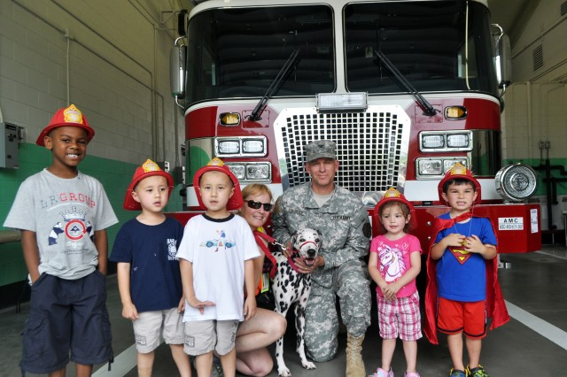 "U.S. Army Garrison Yongsan Commander Col. Michael E. Masley with Yongsan children and Sparky, the Yongsan Fire Station Mascot, following a ""New Fire Stall/Fire Truck"" ribbon cutting ceremony there, June 30. (U.S. Army photo by Pvt. Jung Young Ho)"