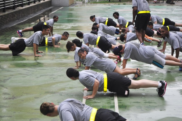 Soldiers from 106th Medical Detachment demonstrated physical readiness training (PRT) exercises and other fun activities to Korean middle school children during their visit to Sunin Church Yongsan Wonyroo, July 13. (U.S. Army photo by Sgt. Kevin Frazier)