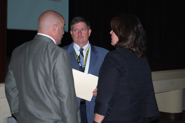 Prior to the Safety Stand Down Day presentation, Dr. Thomas Russell holds a discussion with Scott Adams, chief, Safety and Occupational Health, and Teresa Kines, associate director for laboratory operations.