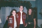 A young Ty Carter and his sister, Amber, try on letterman jackets, a gift from their maternal grandparents, on Christmas day in 1997.