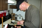 Sgt. Ty Carter makes sushi for his family at his apartment near Joint Base Lewis-McChord, Wash., in February 2012.