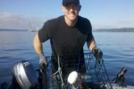 Sgt. Ty Carter goes crabbing for the first time, on South Puget Sound in 2011.