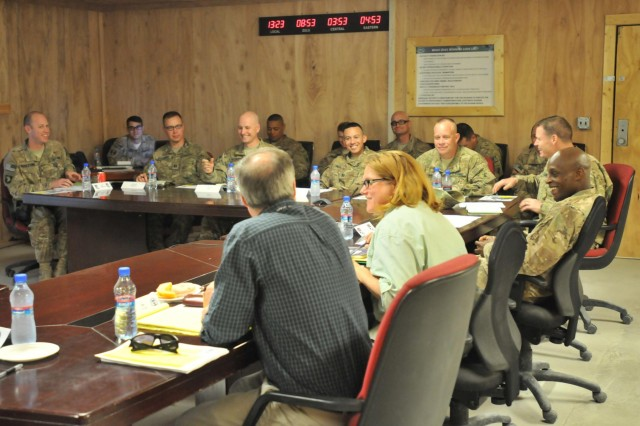 Karen Decker, senior civilian representative to Regional Command-East, shares information with U.S. Soldiers and civilians during a meeting at Forward Operating Base Gamberi, Laghman province, Afghanistan, June 11, 2013. The group discussed civilian-military integration to establish goals and align their operations to ensure a more stable and secure Government of the Islamic Republic of Afghanistan. (U.S. Army photo by Staff Sgt. Richard Andrade/Released)