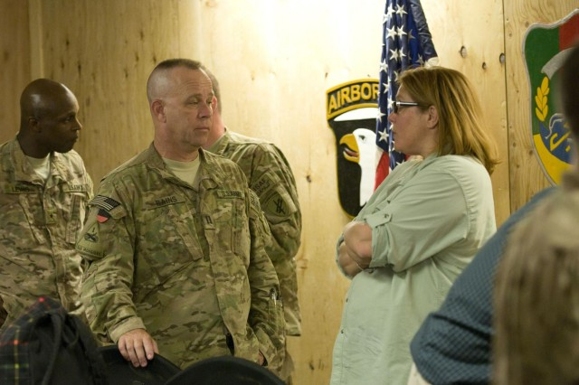 Karen Decker, senior civilian representative to Regional Command-East speaks with U.S. Army Capt. Thomas Rains, assigned to Alpha Company, 486th Civil Affairs Battalion, Oklahoma Army Reserves, following a civilian-military integration meeting held at Forward Operating Base Gamberi, Laghman province, Afghanistan, June 11, 2013. The group discussed civilian-military integration to establish goals and align their operations to ensure a more stable and secure government of the Islamic Republic of Afghanistan.  (U.S. Army photo by Staff Sgt. Richard Andrade/Released)