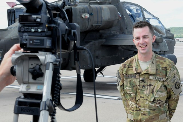 """Staff Sgt. Russ Hagar, an Apache helicopter maintenance quality control noncommissioned officer with the Missouri National Guard's 1st Battalion, 135th Attack Reconnaissance Battalion, does a """"Shout Out"""" to families and friends back home to be used during a telecast of the July 25, 2013 standoff between the St. Louis Cardinals and the Philadelphia Phillies. The aviation battalion, headquartered at Whiteman Air Force Base, Mo., is set to deploy more than 300 Soldiers as an attack and reconnaissance asset to Afghanistan after completing pre-deployment training at Fort Hood, Texas with First Army Division West's 1st Battalion, 291st Aviation Regiment, 166th Aviation Brigade. (Photo by Michael M. Novogradac, Division West Public Affairs)"""