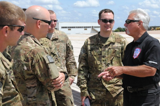 """Al Hrabosky, aka """"The Mad Hungarian,"""" right, a former Major League baseball pitcher from 1970-1982, and a colorful television broadcaster for the St. Louis Cardinals since 1985, talks with Soldiers of the Missouri National Guard's 1st Battalion, 135th Attack Reconnaissance Battalion. Hrabosky was at Fort Hood, Texas' Robert Gray Army Airfield July 18 taking part in """"Shout Outs"""" that will air during a telecast of the July 25, 2013 standoff between the St. Louis Cardinals and the Philadelphia Phillies. (Photo by Michael M. Novogradac, Division West Public Affairs)"""