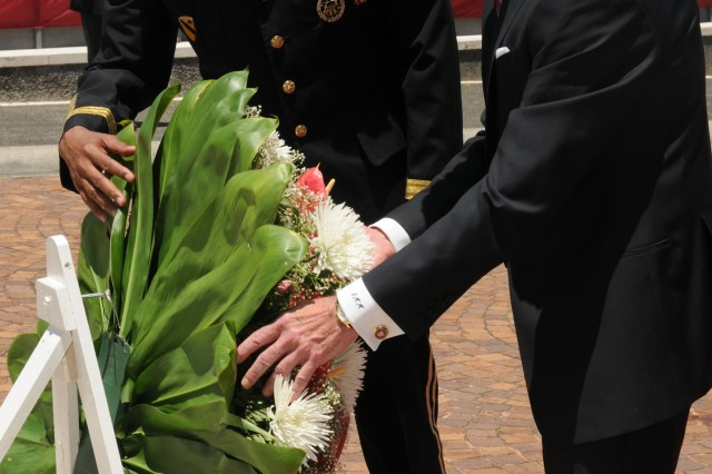 Secretary of the Army John McHugh and Gen Vincent K. Brooks, U.S. Army, Pacific commanding general, place a wreath in honor of the late Senator Daniel K. Inouye at the National Memorial Cemetery of the Pacific on Honolulu, Hawaii.