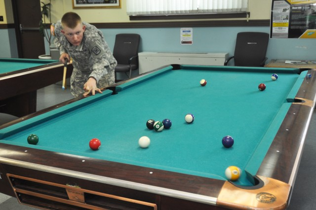Pvt. Ralph Campbell, soldier assigned to Camp Carroll, enjoys a game of pool while waiting on his bus provided by the Yongsan Moyer Recreational Center. (U.S. Army photo by Sgt. Kevin Frazier)