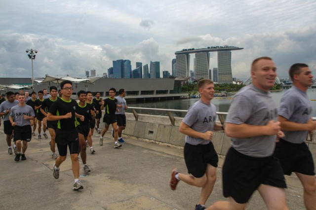 Singaporean soldiers with 2nd Battalion, Singapore Infantry Regiment, run with their U.S. Army counterparts from 4th Battalion, 23rd Infantry Regiment, 2nd Brigade, 2nd Infantry Division, in downtown Singapore, July 19, 2013. The U.S. soldiers are in Singapore supporting Exercise Lighting Strike, a U.S. Army Pacific sponsored platoon-sized event that partners Singaporean and U.S. soldiers. (U.S. Army photo by Staff Sgt. Justin Naylor)