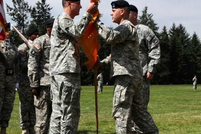 Maj. Gen. Stephen R. Lanza, 7th Infantry Division commander and presiding officer, gives command of the 16th Combat Aviation Brigade to Col. Paul A. Mele during a change of command ceremony July 19 at Watkins Field on Joint Base Lewis-McChord, Wash. Mele replaced Col. Rob P. Dickerson.