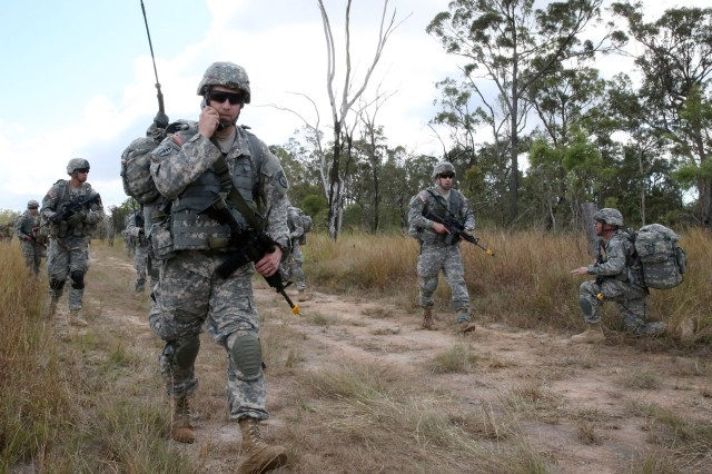 Paratroopers move out after jumping into the Shoalwater Bay Training Area of Queensland, Australia, during Exercise Talisman Saber 2013.