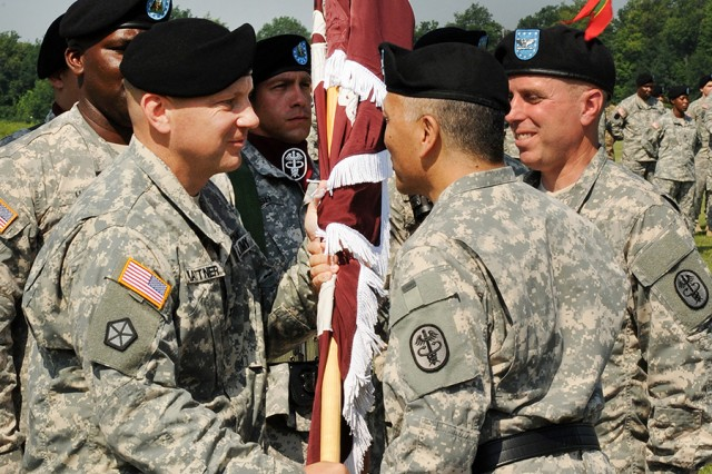 Col. Matthew Mattner, left, accepts the MEDDAC guidon from Maj. Gen. M. Ted Wong, commanding general of Northern Regional Medical Command, as Col. Mark Thompson, right, outgoing MEDDAC commander, looks on during a change of command ceremony last week on post