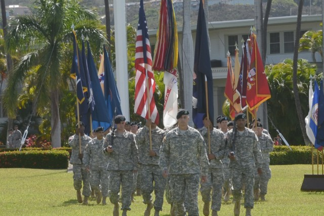 """Soldiers from U.S. Army Pacific performed a """"Flying V"""" ceremony in honor of USARPAC, Chief of Staff, Maj. Gen. James F. Pasquarette. The ceremony was held July 24 at historic Palm Circle on Fort Shafter. The ceremony was officiated by USARPAC Commanding General, Gen. Vincent K. Brooks. The Flying V Ceremony traditionally welcomes or honors senior Army officials when they assume duties, depart or retire from an Army Command. The term """"Flying V"""" refers to the way the colors are posted during the ceremony, which is V shaped."""