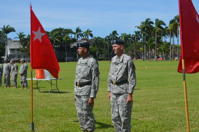 """Soldiers from U.S. Army Pacific performed a """"Flying V"""" ceremony in honor of USARPAC, Chief of Staff, Maj. Gen. James F. Pasquarette (right). The ceremony was held July 24 at historic Palm Circle on Fort Shafter. The ceremony was officiated by USARPAC Commanding General, Gen. Vincent K. Brooks (left). The Flying V Ceremony traditionally welcomes or honors senior Army officials when they assume duties, depart or retire from an Army Command. The term """"Flying V"""" refers to the way the colors are posted during the ceremony, which is V shaped."""