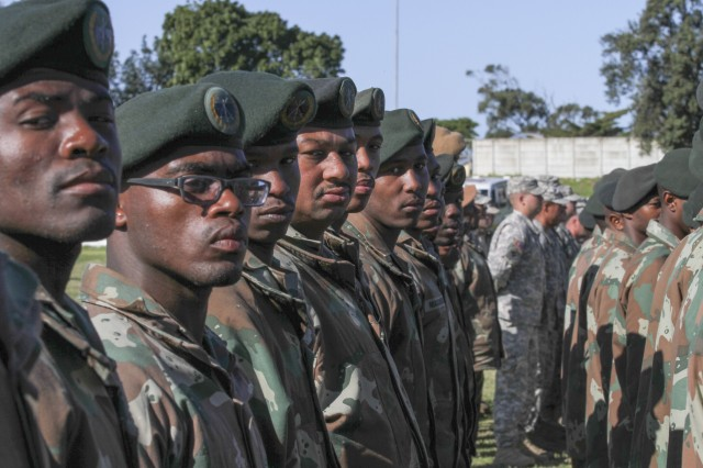 Soldiers from the U.S. and South Africa stand in formation during the opening ceremony for Shared Accord 13 at Port Elizabeth, South Africa, July 24, 2013. Shared Accord is a biennial training exercise which promotes regional relationships, increases capacity, trains U.S. and South African forces, and furthers cross-training and interoperability.
