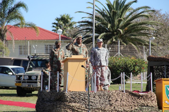 South African Maj. Gen. Ephraim Phako, deputy chief of Joint Operations, salutes the formation of U.S. and South African service members, July 24, 2013, during the opening ceremony of Exercise Shared Accord 13 in Port Elizabeth, South Africa. Shared Accord is a biennial training exercise which promotes regional relationships, increases capacity, trains U.S. and South African forces, and furthers cross-training and interoperability.