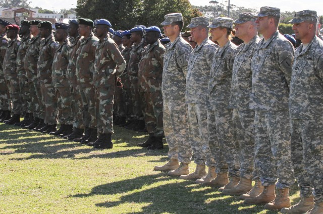 Military members from the U.S. and South Africa stand in formation during the opening ceremony for Shared Accord 13 at Port Elizabeth, South Africa, July 24, 2013. Shared Accord is a biennial training exercise which promotes regional relationships, increases capacity, trains U.S. and South African forces, and furthers cross-training and interoperability.