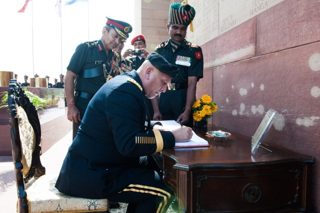 Chief of Staff Gen. Raymond T. Odierno partakes in a wreath laying ceremony and a visitor book signing, during his visit to India to strengthen the relationship between the U.S. and Indian Army, in New Delhi, July 24, 2013.