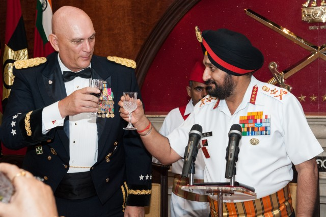 U.S. Army Chief of Staff Gen. Raymond T. Odierno and India Chief of Army Staff Gen. Bikram Singh make a toast at the Indian Army Banquet, hosted by Singh in honor of Odierno, during his visit to India to strengthen the relationship between the U.S. and Indian Army, in New Delhi, July 24, 2013.