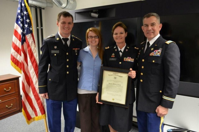 Chief Warrant Officer Sheliene Blombach stands with her husband, Lt. Col. Chris Blombach, son, Spc. Daniel Stephens, and daughter Amanda after she is promoted to Chief Warrant Officer 3.