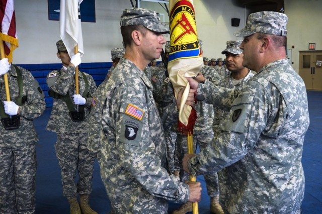 Col. Jordan S. Chroman (left) accepts the 403rd Army Field Support Brigade unit colors from Army Sustainment Command Commanding General Maj. Gen. John F. Wharton during a change of command ceremony at Kelly Gym, Camp Walker, Daegu, Korea, June 26.  (Photo by Cpl. Im Yeong-Rok, 403rd AFSB Public Affairs)