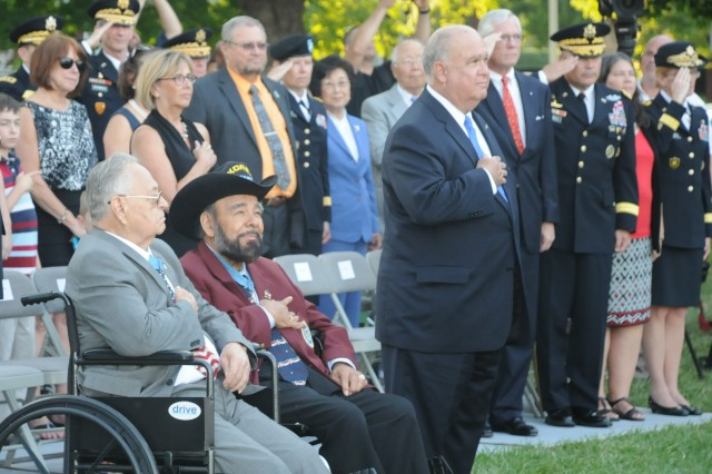 "Medal of Honor recipients retired Sgt. 1st Class Ron Rosser (left) and Cpl. Rodolfo ""Rudy"" Hernandez (middle) render honors along with the Under Secretary of the Army Joseph W. Westphal, Ph.D., during the U.S. Army Military District of Washington's Twilight Tattoo at Joint Base Myer-Henderson Hall's (Va.) Whipple Field, July 24, 2013.  The high-energy show's theme 'Heroes Remembered' commemorates the 60th Anniversary of the signing of the Korean War Armistice."