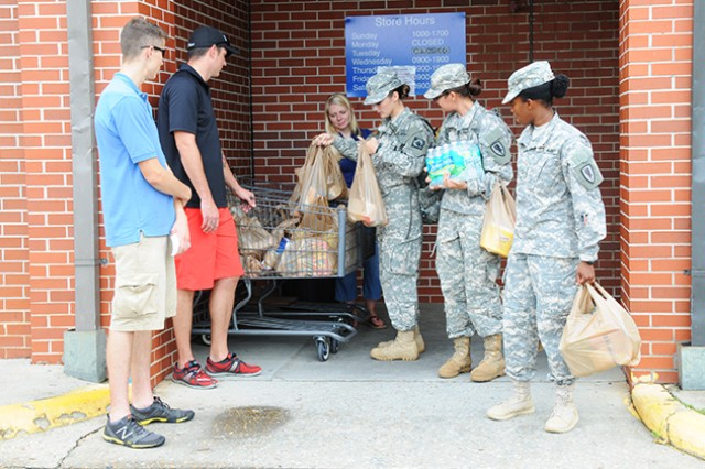 Soldiers give back during food drive