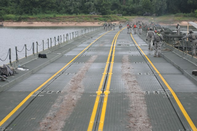 U.S. Soldiers inspect an Improved Ribbon Bridge following its completion during Operation River Assault at Fort Chaffee, Ark., July 24, 2013. The bridge completion was the final exercise for nearly 800 Soldiers representing both the Army Reserve and active-duty.