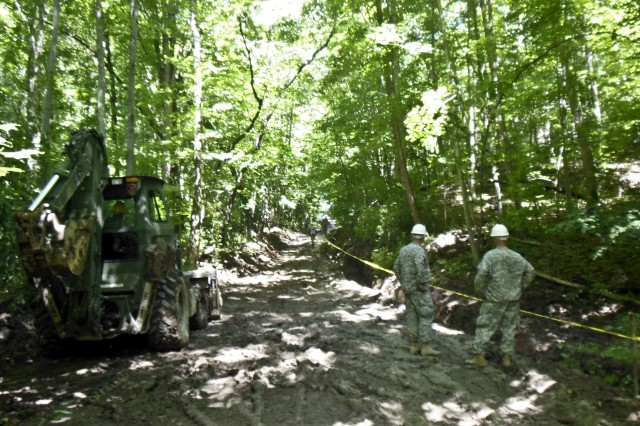 The road to Loyalhanna Lake's Sportsman's Access Area got a partial facelift by Army Reserve engineer troops from the 340th Engineer Co., New Kensington, Pa., in July. The work not only provided realistic training, but provided a low cost solution for infrastructure repair at the Corps of Engineers project and better access for visitors.