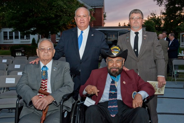 "Under Secretary of the Army Joseph W. Westphal (standing, center) honors Korean War Medal of Honor recipients Mr. Ronald E. Rosser (sitting, left) and Mr. Rodolfo Hernandez (sitting, right) during a special Twilight Tattoo to recognize the 60th Anniversary of the Korean War Armistice, July 24, 2013, at Joint Base Myer-Henderson Hall, Arlington Va. About 1,000 people, including 400 Korean War Veterans, attended the Twilight Tattoo, which showcases the military precision and discipline of the 3d U.S. Infantry Regiment (The Old Guard) and The U.S. Army Band (""Pershing's Own""). The special Twilight Tattoo was the kick-off event for the Department of Defense's recognition of the 60th Anniversary of the Korean War Armistice (www.koreanwar60.com). (Photo Credit: Army Sgt. Laura M. Buctha)"
