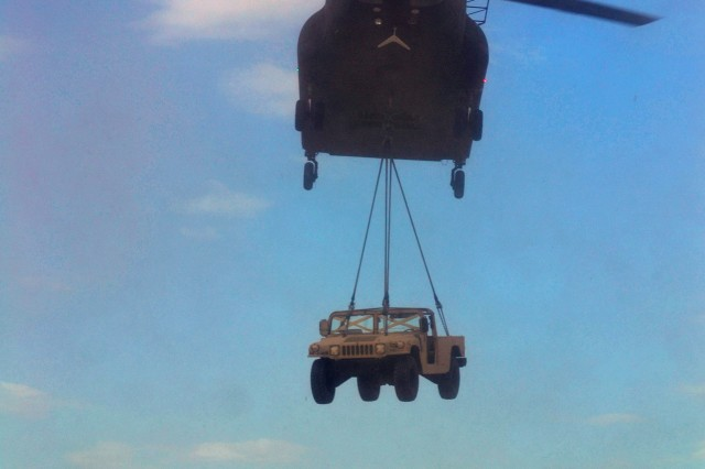 A CH-47 Chinook from 2nd General Support Aviation Battalion, 4th Aviation Regiment, 4th Combat Aviation Brigade, 4th Infantry Division, sling-loads a Humvee during 4th CAB's first field training exercise, on Fort Carson, Colo., July 25, 2013.