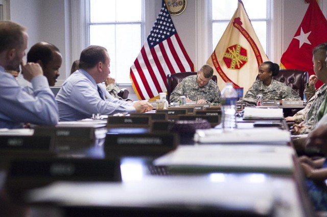 Maj. Gen. Jeffrey S. Buchanan, commander Joint Force Headquarters-National Capital Region and Military District of Washington, arrives at the conference room in Bldg. 59 on Joint Base Myer-Henderson Hall July 22, 2013. This was Buchanan's first official tour of the joint base.