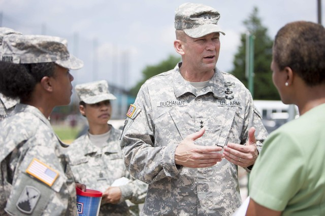 Joint Force Headquarters-National Capital Region and Military District of Washington Commander Maj. Gen. Jeffrey S. Buchanan (center) speaks to Joint Base Myer-Henderson Hall Commander Col. Fern O. Sumpter (left), Command Sgt. Maj. Earlene Y. Lavender (second from left) and Family and Morale, Welfare and Recreation Director Denise James (right) during his first official tour of the joint base July 22.
