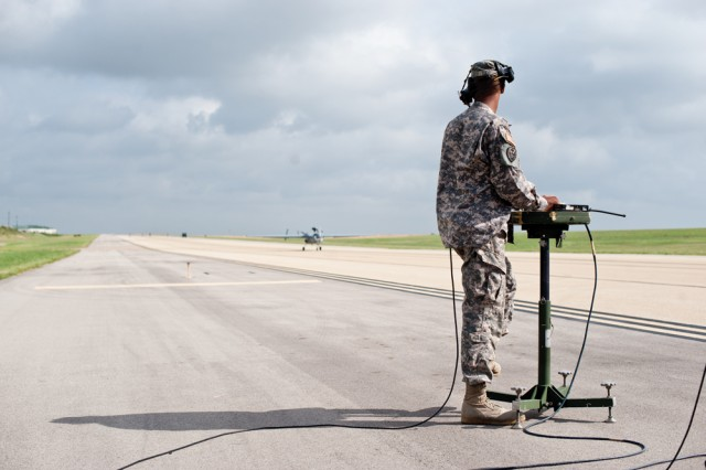 Staff Sgt. Charles Lee, of the 15th MI Battalion, performs his external operator duties while landing the MQ-5B Hunter unmanned aerial system at Robert Gray Army Airfield, Fort Hood, Texas.