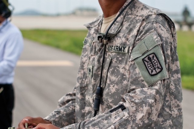 Staff Sgt. Charles Lee uses a remote-controlled device to operate the MQ-5B Hunter unmanned aerial system.