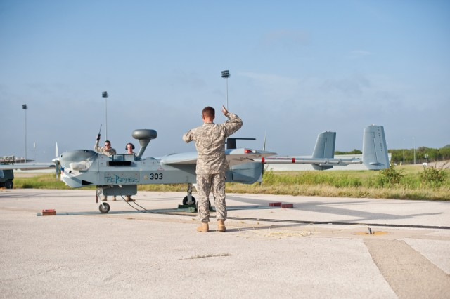 Soldiers from the 15th MI Battalion complete ground runs on the MQ-5B Hunter unmanned aerial system.