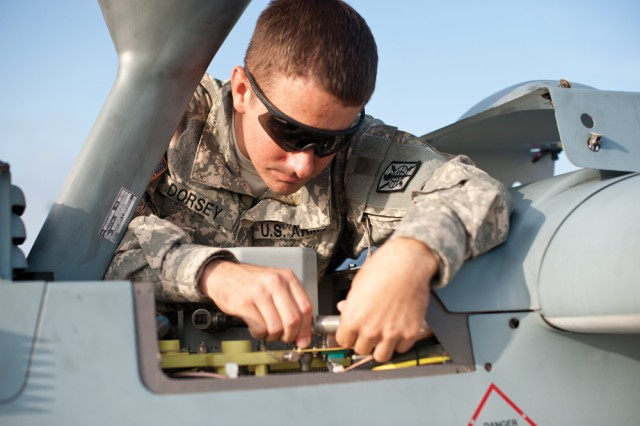 Staff Sgt. William Dorsey conducts routine maintenance with the 15th MI Battalion on the MQ-5B Hunter unmanned aerial system prior to take off.