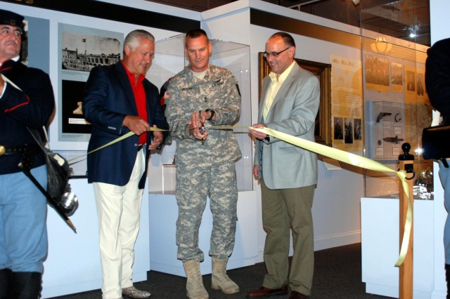 "Lance Ingmar, president of the Friends of the New York State Military Museum (left) and Courtney Burns, museum curator and acting manager of the New York State Military Museum, join Maj. Gen. Patrick Murphy, the adjutant general of New York in cutting a ribbon officially opening the new Civil War exhibit  ""Empire for Union,"" July 27."