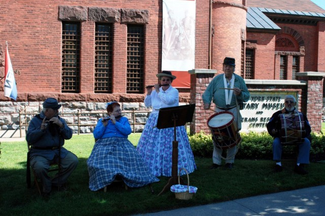 A band of Civil War re-enactors play period music outside the New York State Military Museum to set the mood as Maj. Gen. Patrick Murphy, the adjutant general of New York, cut the ribbon officially opening the new Civil War exhibit, July 27. (Photo by Eric Durr/ DMNA)
