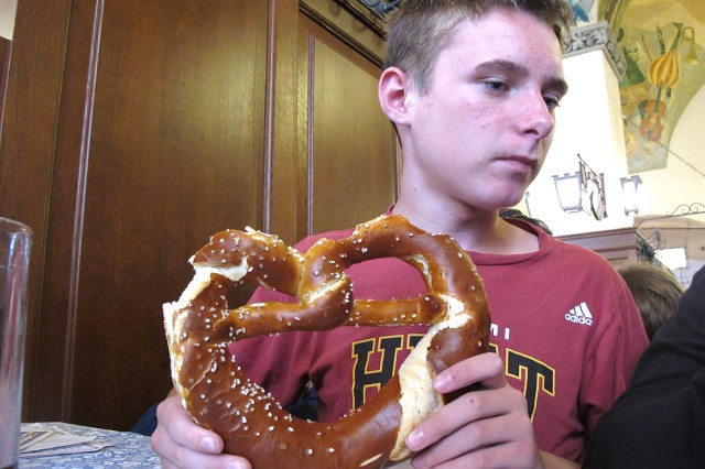 Joel Philpott, 13, snacks on a traditional Bavarian brezel (pretzel) while dining out in Germany.