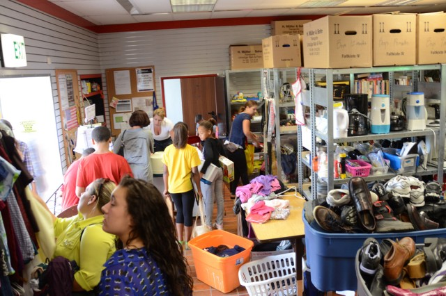 Community members root through a plethora of free items at the Freecycle Center on Tower Barracks in Grafenwoehr, July 31.
