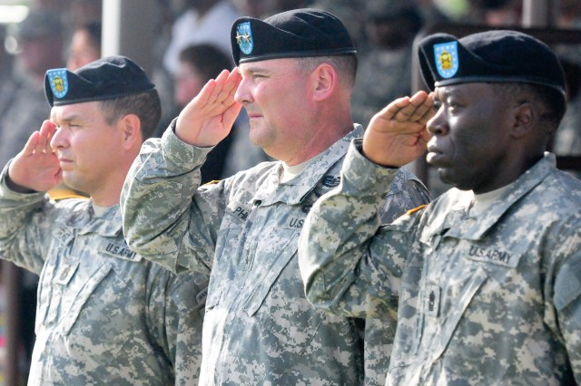Command Sgt. Maj. Ronald E. Orosz, left, First Army Division West outgoing command sergeant major, Maj. Gen. Warren E. Phipps Jr., center, First Army Division West commanding general, and Command Sgt. Maj. Steven B. Brown, First Army Division West incoming command sergeant major, salute the American flag during a change of responsibility ceremony on Cameron Field near Division West headquarters at Fort Hood, Texas, July 30. (Photo by Staff Sgt. Tony Foster, Division West Public Affairs)