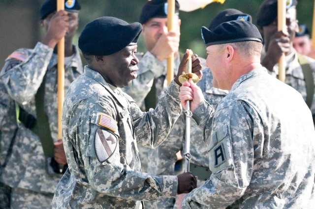 Command Sgt. Maj. Steven B. Brown, left, First Army Division West command sergeant major, accepts the Noncommissioned Officer Sword from Maj. Gen. Warren E. Phipps Jr., First Army Division West commanding general, during a change of responsibility ceremony on Cameron Field at Fort Hood, Texas, July 30. Brown assumed responsibility of Division West from Command Sgt. Maj. Ronald E. Orosz, who led the unit since October 2011. (Photo by Staff Sgt. Tony Foster, Division West Public Affairs)