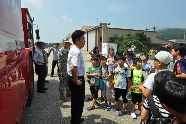 Participants of the Segok-dong office English Camp go through a lecture and demonstration session given by K-16 fire station employees during the camp's K-16 tour, July 25. (U.S. Army photo by Pfc. Jung Jihoon)