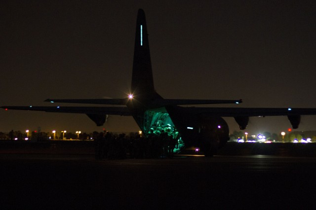 U.S. and South African Soldiers board the C-130 aircraft for a nighttime practice jump at Bloemspruit Airbase, South Africa, July 23. The jump was in preparation for an exercise that U.S. and South African Soldiers will conduct jointly during Shared Accord 13. Shared Accord is a biennial training exercise which promotes regional relationships, increases capacity, trains U.S. and South African forces, and furthers cross-training and interoperability. The jump will also earn each Soldier a pair of foreign wings for either jumping in a foreign country or jumping with a foreign country's jumpmasters.