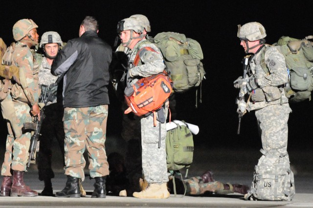 82nd Airborne Division Paratroopers negotiate with a role player after a tactical air landing operation (TALO) as part of Exercise Shared Accord in East London, July 26.  Shared Accord is a biennial training exercise which promotes regional relationships, increases capacity, trains U.S. and South African forces, and furthers cross-training and interoperability.