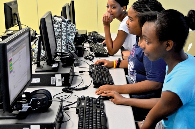 Nya Thomas (from left), Nya Myles and Ameera Mustafa work on projects during a Summer Enrichment Program class.