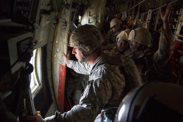 Jumpmaster, U.S. Army Capt. Craig D. Arnold, commander of Charlie Company, 1st Battalion, 325th Airborne Infantry Regiment, 82nd Airborne Division from Fort Bragg, N.C., looks out the window of the C-130J aircraft to prepare for a partnership jump over the Mimosa Flat Drop Zone, South Africa, July 23. The jump was in preparation for an exercise that South African and U.S. Soldiers will conduct jointly during Shared Accord 13. Shared Accord is a biennial training exercise which promotes regional relationships, increases capacity, trains U.S. and South African forces, and furthers cross-training and interoperability. The jump also earned each Soldier a pair of foreign wings for either jumping in a foreign country or jumping with a foreign country's jumpmasters.